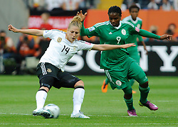30.06.2011, Commerzbank-Arena, Frankfurt, GER, FIFA Women Worldcup 2011, GRUPPE A, Deutschland (GER) vs. Nigeria (NGR) , im Bild Kim Kulig (Deutschland #14, Hamburg) im Zweikampf mit Desire OPARANOZIE (NGA #9,Delta Queens) // during the FIFA Women Worldcup 2011, Pool A, Germany vs. Nigeria on 2011/06/30, Commerzbank-Arena, Frankfurt, Germany. EXPA Pictures © 2011, PhotoCredit: EXPA/ nph/  Roth       ****** out of GER / CRO  / BEL ******