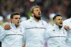 George Ford, Chris Robshaw and Danny Care of England sing the national anthem - Mandatory byline: Patrick Khachfe/JMP - 07966 386802 - 19/03/2016 - RUGBY UNION - Stade de France - Paris, France - France v England - RBS Six Nations.