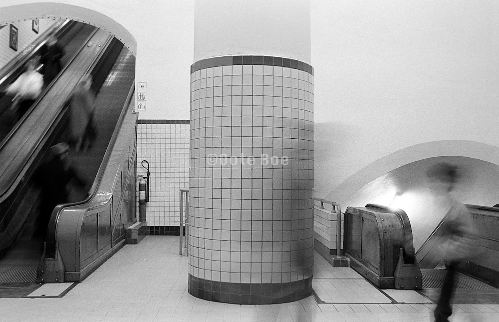 people bustling in subway