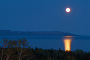 Moon rising over Lake Superior at dusk<br /> Thunder Bay<br /> Ontario<br /> Canada