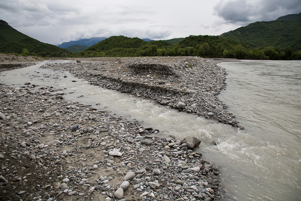 The braided stream bed of the Vjosa River, near its headwaters on the Albanian border with Greece. The river runs for more than 207 kilometers (169 miles) to the sea, unchecked by dams or any other hydropower projects. The river system, which includes tributaries, is part of the last major wild river in Europe. Because the river is unregulated, the gravel moves, allowing it to be transported downriver, changing the shape of the bed and providing spawning grounds for eels and aquatic species.