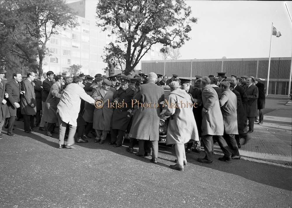 National Farmer's Association attack the car of Charlie Haughey, Minister for Agriculture. N.F.A. members surround and stop Mr. Haughey's car as he enters the Intercontinental Hotel to open the 5th Annual Congress of the British Equine Veterinary Association<br /> 25.10.1966