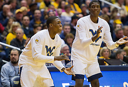 Jan 7, 2017; Morgantown, WV, USA; West Virginia Mountaineers guard Teyvon Myers (0) and West Virginia Mountaineers forward Lamont West (15) cheer from the bench during the first half against the TCU Horned Frogs at WVU Coliseum. Mandatory Credit: Ben Queen-USA TODAY Sports