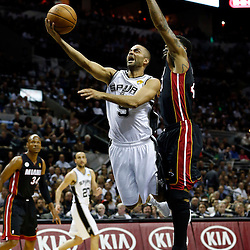 Jun 13, 2013; San Antonio, TX, USA; San Antonio Spurs point guard Tony Parker (9) drives to the basket against Miami Heat power forward Udonis Haslem (40) during the first quarter of game four of the 2013 NBA Finals at the AT&T Center. Mandatory Credit: Derick E. Hingle-USA TODAY Sports