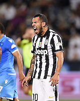 FUSSBALL INTERNATIONAL Supercoppa Italia Finale 2014 in Doha  Juventus Turin - SSC Neapel         22.12.2014 Carlos Tevez (Juventus Turin) emotional