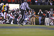 Ole Miss' Jeff Scott (3) runs vs. Auburn at Jordan-Hare Stadium in Auburn, Ala. on Saturday, October 29, 2011. .