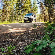 Teton Science Schools van drives down a dirt road near Grand Teton National Park, Wyoming.