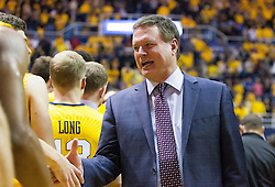 Jan 24, 2017; Morgantown, WV, USA; Kansas Jayhawks head coach Bill Self shakes hands with West Virginia Mountaineers players after the game at WVU Coliseum. Mandatory Credit: Ben Queen-USA TODAY Sports