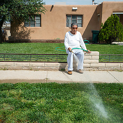 090313       Brian Leddy<br /> Eighty-five year-old Joe Bernao waters his lawn in the Indian Hills neighborhood Tuesday morning. Bernao say he takes it slow when it comes to yard work these days, mowing different parts of his yard on different days to break up the work load.