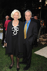 Actress HONOR BLACKMAN and actor NICKOLAS GRACE  at the Goring Hotel Summer party, Goring Hotel, 15 Beeston Place, London on 17th September 2008.