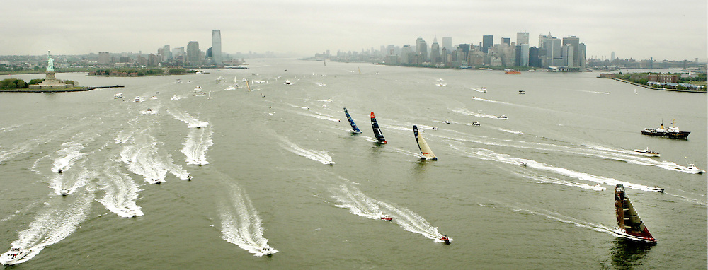 Race yachts sail out of New York harbor with the skyline and Statue of Liberty in the background during the start of leg seven of the Volvo Ocean Race to Portsmouth, England Thursday, 11 May 2006 in New York.