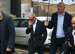 © Licensed to London News Pictures. 29/10/2015. Bournemouth, UK. Paul Gascoigne (C) arrives at Bournemouth Magistrates Court on harassment charges. Photo credit: Peter Macdiarmid/LNP