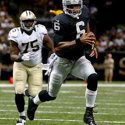 Aug 16, 2013; New Orleans, LA, USA; Oakland Raiders quarterback Terrelle Pryor (6) against the New Orleans Saints during the second half of a preseason game at the Mercedes-Benz Superdome. The Saints defeated the Raiders 28-20. Mandatory Credit: Derick E. Hingle-USA TODAY Sports