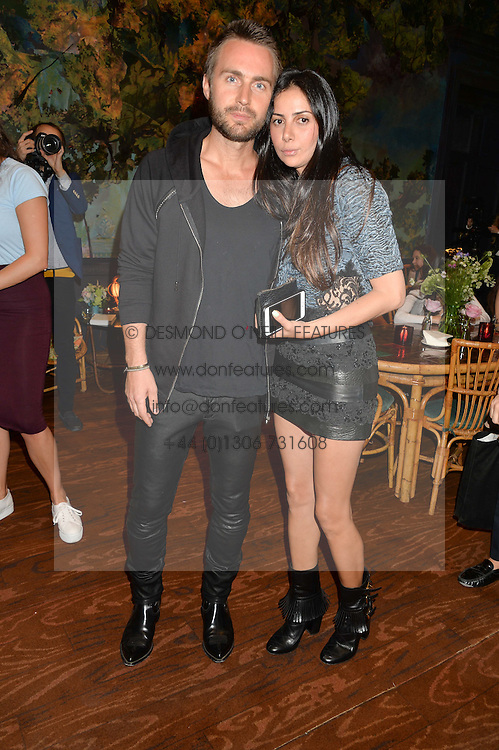 KRISTIAN AADNEVIK and HILA BITTON-AADNEVIK at a tea party to launch Grace Gura held at Sketch, 9 Conduit Street, London on 17th June 2015.