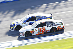 April 29, 2018 - Talladega, Alabama, United States of America - Chase Elliott (9) and David Ragan (38) battle for position during the GEICO 500 at Talladega Superspeedway in Talladega, Alabama. (Credit Image: © Chris Owens Asp Inc/ASP via ZUMA Wire)