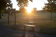 The sun rises at dawn over Ruskin Park, on 30th July 2020, in Lambeth, south London, England.