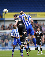 Picture by Graham Crowther/Focus Images Ltd. 07763140036.31/03/12.Rob Jones (c) of Sheffield Wednesday challanges Graham Cummins of Preston North End during the Npower League 1 match at Hillsborough stadium, Sheffield..