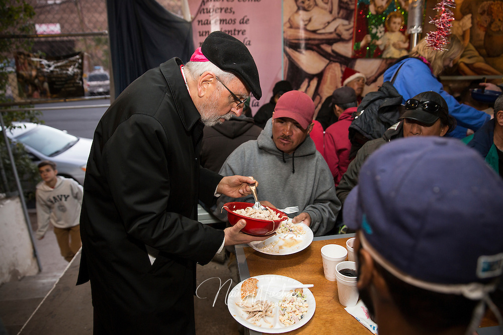 "Bishop Gerald F. Kicanas of Tucson serves men at the ""comedor,"" the kitchen and dining hall of the Aid Center for Deported Migrants in Nogales, Mexico, Dec. 20.  Bishop Kicanas and Nogales Bishop Jose Leopoldo Gonzalez Gonzalez visited with migrants after taking part in a bi-national ""posada,"" a commemoration of Mary and Joseph's search for a place to give birth to Jesus. (CNS photo/Nancy Wiechec)"