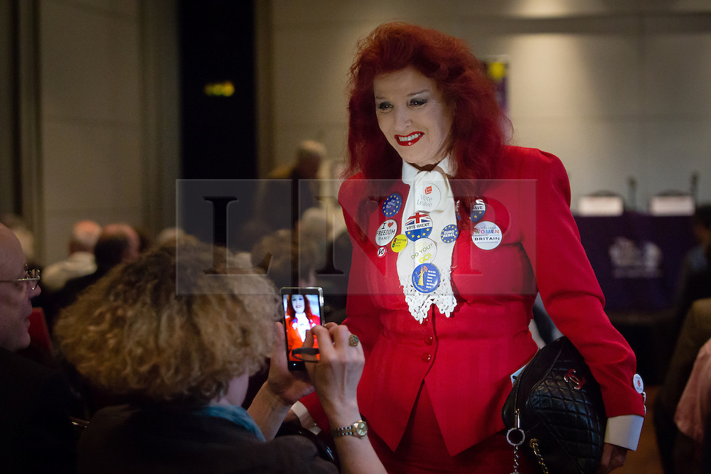 "© Licensed to London News Pictures. 14/06/2016. LONDON, UK.  A delegrate takes a photo of a Vote Leave supporter with many Vote Brexit and Vote Leave badges at the Bruges Group European referendum Brexit event in favour of ""Leave"" on 13th June 2016. The Brexit event, was led by Lord David Owen who warned of the dangers to global stability posed by the EU withdrawing its support for NATO and committing to a European Defence Force. Owen called for a greater European commitment to NATO and the one billion euro budget of the EU's European External Action Service to be immediately transferred to NATO.  Photo credit: Vickie Flores/LNP"