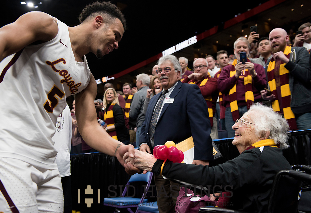 Loyola University Chicago basketball player Marques Townes (5) greets Loyola super fan Sister Jean Dolores Schmidt, BVM, after the Ramblers topped Bradley University during the semifinals of the Missouri Valley Conference men's basketball tournament at Scottrade Center in St. Louis Saturday, March 3, 2018. LUC won, 62-54. Photo © copyright 2018 Sid Hastings.