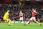 Arsenal Forward Pierre-Emerick Aubameyang (14) takes a shot at goal during the Europa League round of 16, leg 2 of 2 match between Arsenal and Rennes at the Emirates Stadium, London, England on 14 March 2019.