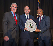 Nathan Graf, center, accepts an award for the Houston ISD Green Buses Program from Daniel Sullenbarger, left, and Sylvester Turner, right, during the Keep Houston Beautiful Mayor's Proud Partner Awards luncheon at the Hilton Americas, November 7, 2016.