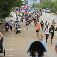 Runners pack main street as they leave the starting line as the Gumtree run starts in downtown Tupelo Saturday morning.