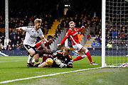 Fulham defender Tim Ream (13) follows up on a spillage from Barnsley goalkeeper Adam Davies (1) during the EFL Sky Bet Championship match between Fulham and Barnsley at Craven Cottage, London, England on 23 December 2017. Photo by Andy Walter.