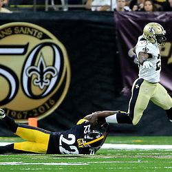 Aug 26, 2016; New Orleans, LA, USA;  New Orleans Saints running back C.J. Spiller (28) breaks a tackle by Pittsburgh Steelers cornerback William Gay (22) during the first half of a preseason game at Mercedes-Benz Superdome. Mandatory Credit: Derick E. Hingle-USA TODAY Sports
