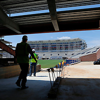 Thomas Wells | Buy at PHOTOS.DJOURNAL.COM<br /> Crews make their way out on the field from under the new North endzone expansion at Vaught-Hemmingway Stadium in Oxford.
