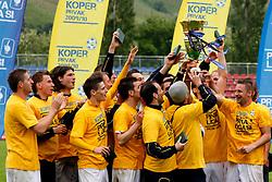 Players of Koper celebrate championship after the football match between NK Nafta Lendava and NK Luka Koper of PrvaLiga league on May 16, 2010 in Lendava, Slovenia. Nafta lost 1 : 2, Koper became National champion.  (Photo by Urban Urbanc / Sportida)