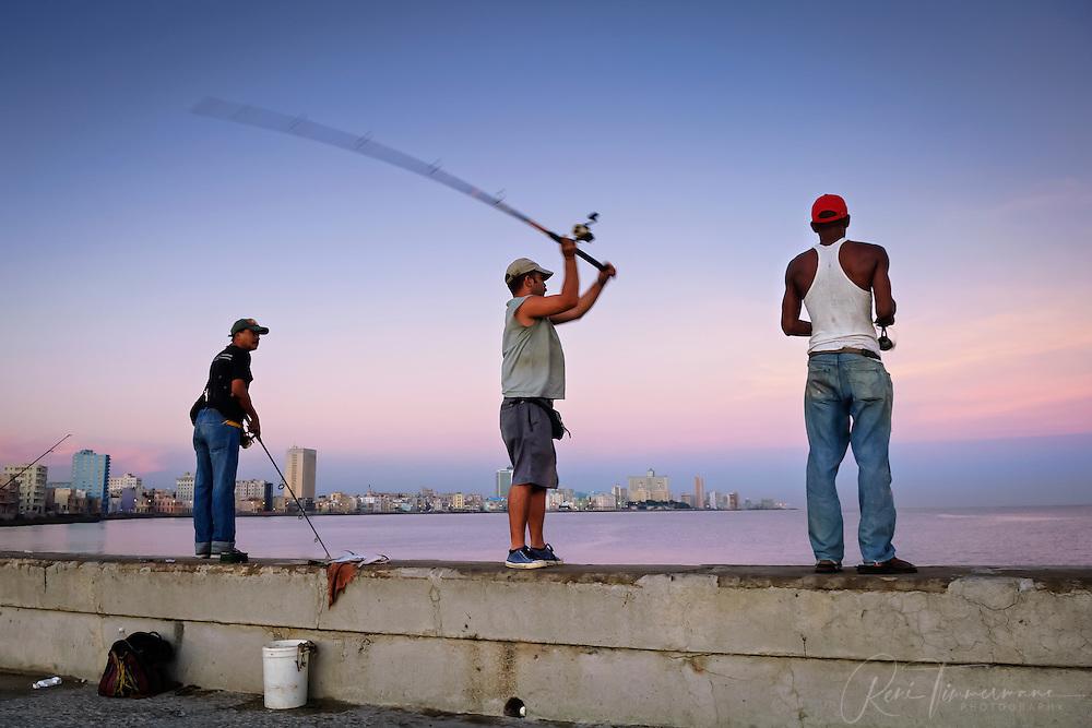 Men fishing at sunrise