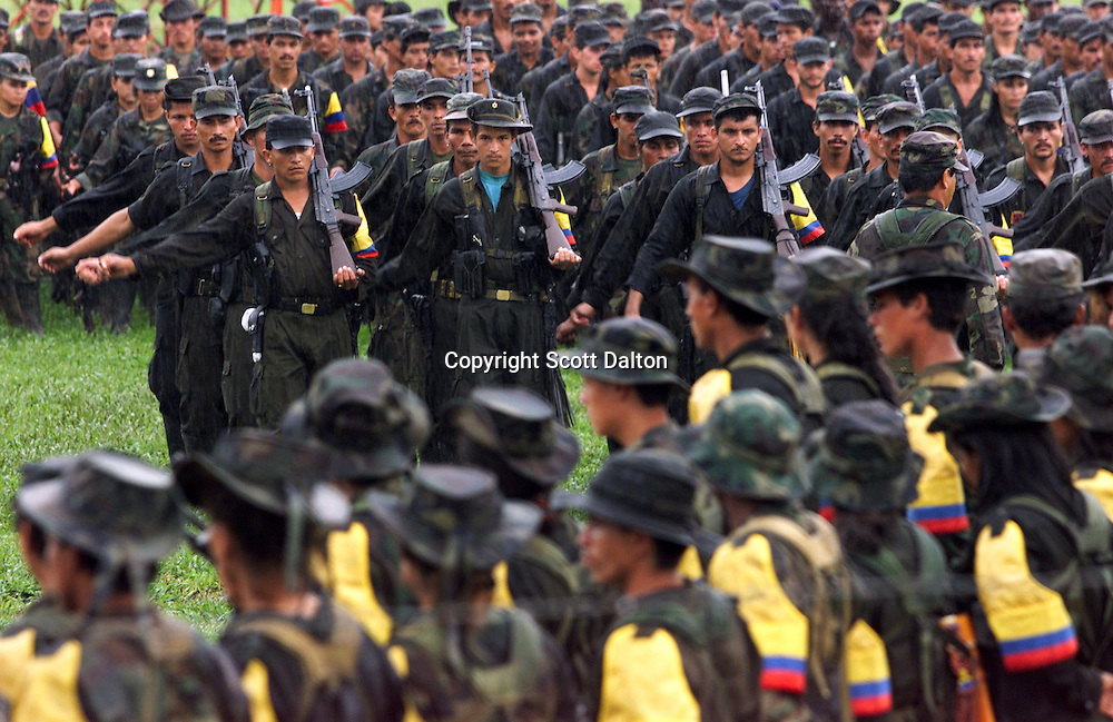 FARC rebels march in formation just outside of San Vicente del Caguan in the former FARC controlled zone of Colombia. The FARC are Colombia's oldest and largest rebel group numbering over 18,000 rebels. (Photo/Scott Dalton)