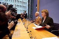 15 NOV 2004, BERLIN/GERMANY:<br /> Edmund Stoiber (L), CSU, Ministerpraesident Bayern, und Angela Merkel (R), CDU Bundesvorsitzende, Fotojournalisten und Kameraleute, vor Beginn einer Pressekonferenz zur Reform der gesetzlichen Krankenversicherung, Bundespressekonferenz<br /> Edmuns Stoiber (L), Minister President Bavaria, and Angela Merkel (R), Chairwoman of the Christian Democratic Union, before a press conference<br /> IMAGE: 20041115-01-008<br /> KEYWORDS: BPK, Kamera, Camera, Fotografen, Journalisten, Journalist
