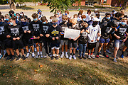 07 SEPTEMBER 2020 - DES MOINES, IOWA:High school athletes picket the Iowa Governor's Mansion. About 300 Des Moines Public School (DMPS) high school athletes marched through Des Moines to the Governor's Mansion Monday to protest Gov. Kim Reynolds' recent efforts to reopen schools. DMPS, the largest school district in Iowa, is suing to go to online instruction because of the COVID-19 pandemic. The Governor is trying to force the district to reopen with in person instruction. The state ruled that schools using online education can't participate in extracurricular activities, including sports. The student athletes, who all wore face masks to comply with CDC guidelines, were marching to demand the ability to participate in sports despite using online instruction.       PHOTO BY JACK KURTZ