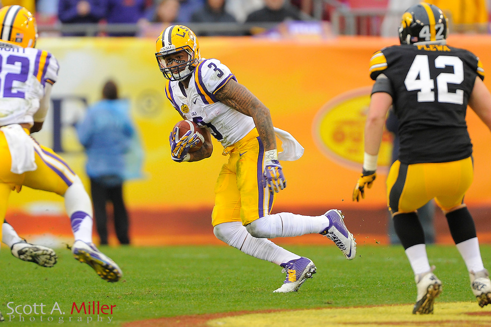 LSU Tigers wide receiver Odell Beckham (3) runs upfield with the ball during LSU's 21-14 win over the Iowa Hawkeyes in the 2014 Outback Bowl at Raymond James Stadium on Jan 1, 2014  in Tampa, Florida.            ©2014 Scott A. Miller