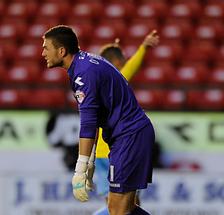Walsall's Richard O'Donnell cuts a dejected figure as Crystal Palace's Dwight Gayle celebrates his hat-trick behind him - Photo mandatory by-line: Dougie Allward/JMP - Mobile: 07966 386802 26/08/2014 - SPORT - FOOTBALL - Walsall - Bescot Stadium - Walsall v Crystal Palace - Capital One Cup
