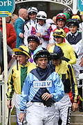 The jockeys enter the Parade Ring for The Listed Langleys Solicitors British EBF Marygate Fillies Stakes over 5f (£50,000)  during the third day of the Dante Festival at York Racecourse, York, United Kingdom on 17 May 2019.