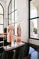 """ROME, ITALY - 15 OCTOBER 2018: FENDI Haute Couture dresses are seen here during the LVMH Journées Particulières exhibition at the Fendi headquarters in Rome, Italy, on October 15th 2018.<br /> <br /> The LVMH Journées Particulières is is a series of exhibitions that show the creations and history of the LVMH fashion houses. The driving theme behind the Journées Particulières is to allow the general public to discover the inner workings of the Houses which are part of the LVMH heritage.The LVMH Journées Particulières exhibition by fashion house FENDI takes place at their headquarters at the Palazzo della Civiltà Italiana, also called the """"Colosseo Quadrato"""" (Square Colosseum),  an outstanding jewel of the 20th century Roman architecture."""