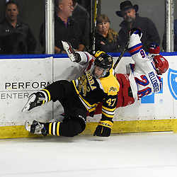 BUFFALO, NY - SEP 21,  2017: Ontario Junior Hockey League Governors Showcase game between the Aurora Tigers and Oakville Blades, Jacob Kostopoulos #47 of the Aurora Tigers makes the hit on Matthew Kellenberger #26 of the Oakville Blades during the first period.<br /> (Photo by Andy Corneau / OJHL Images)