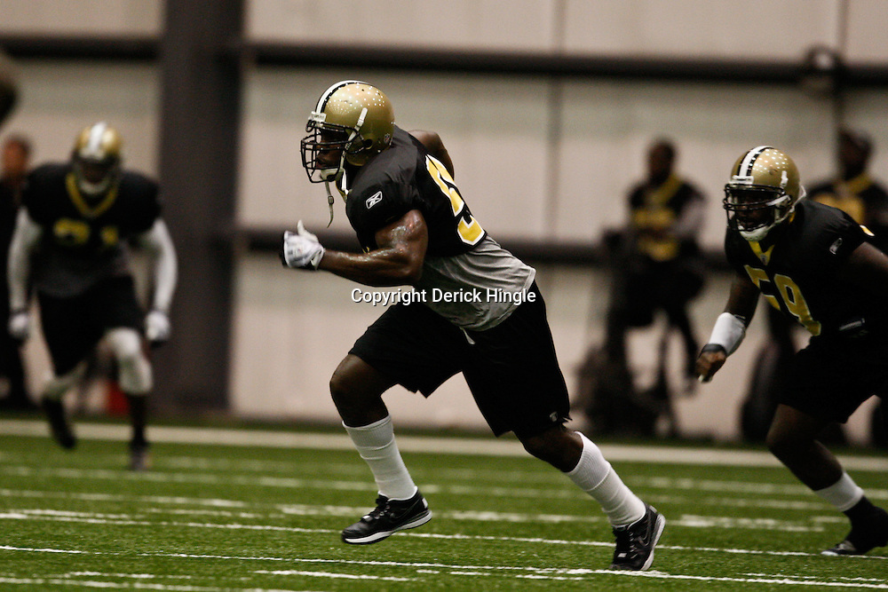 July 30, 2010; Metairie, LA, USA; New Orleans Saints linebacker Jonathan Vilma (51) runs a drill during a training camp practice at the New Orleans Saints indoor practice facility. Mandatory Credit: Derick E. Hingle