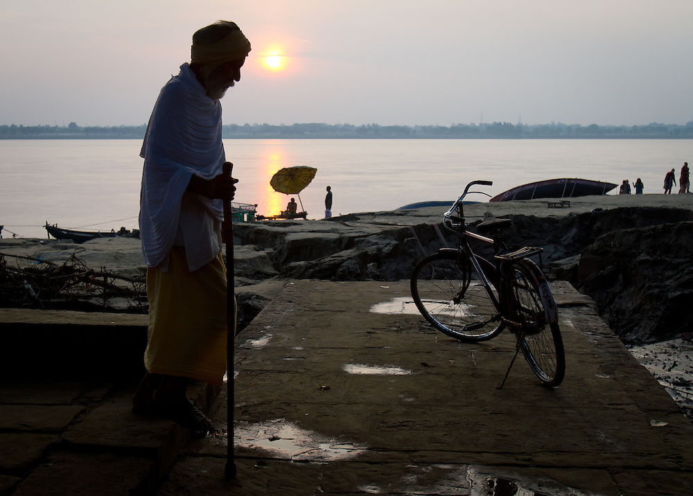 An old man walks alone near the Ganges River in Varanasi, India, the holiest city in Hinduism. For Hindu's, to die and to be cremated in Varanasi means freedom from the cycle of rebirth therefore many people close to death come to spend their last days near the holy river.