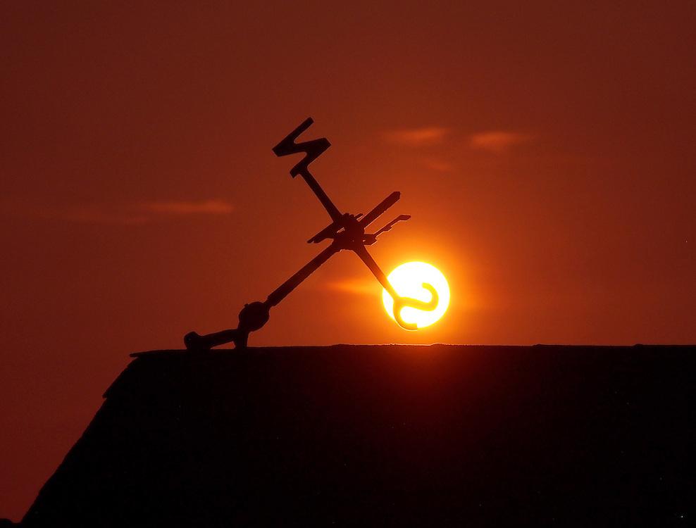 Americana.<br /> <br /> Broken wind vane at sunrise, Bass Harbor, Maine.