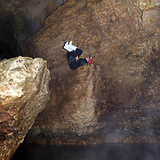 Black Water rafting in the Waitomo Glowworm Caves, Waitomo, North Island, New Zealand..The Legendary Black Water Rafting Company is New Zealand's first black water adventure tour operator which takes tourists through the  Ruakuri Cave at Waitomo..The five hour expedition combines abseiling the 35 metre entrance. climbing, a flying fox. black water tubing, leaping and floating through Ruakuri Cave and observing glow worms. The journey concludes  into the sunlight of the Waitomo forest..Waitomo, New Zealand,, 14th December  2010 Photo Tim Clayton