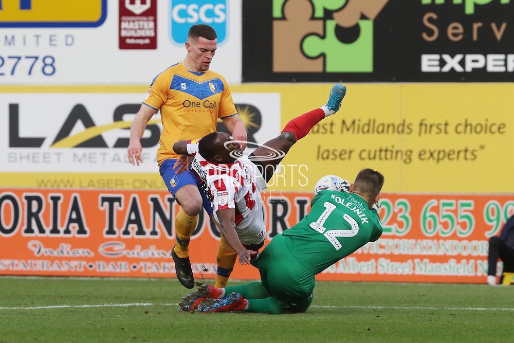 Matt Preston, Alex Addai and Bobby Olejnik  during the EFL Sky Bet League 2 match between Mansfield Town and Cheltenham Town at the One Call Stadium, Mansfield, England on 7 December 2019.