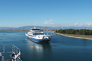 Ferry boat enters the port of Thasos on the Greek island of Thasos