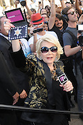 Sept. 4, 2014 - Joan Rivers, the queen of comedy, has died in New York. She was 81. Rivers was undergoing surgery on her vocal cords at a clinic in New York City on Aug. 28 when she stopped breathing and had to be transported to Mount Sinai Hospital. Rivers entered show biz as a stand-up comic. She first gained fame with her appearances on ''The Tonight Show'' with Johnny Carson. Rivers recently transformed herself into a comedian fashion critic  of the red carpet with the popular E! Network show, 'Fashion Police.' <br /> <br /> PICTURED: Sept. 5, 2013 - New York, New York, U.S. - Comedian JOAN RIVERS flashes her Fashion Police credentials Joan Rivers at Lincoln Center during Mercedes Benz Fashion Week.<br /> ©Exclusivepix