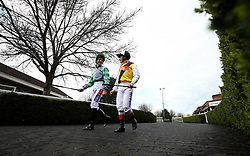 General view of jockey's Fran Berry and Andrea Atzeni walking into the parade ring before the Matchbook Betting Podcast Rosebery Handicap during the Easter Family Fun Day at Kempton Park Racecourse. PRESS ASSOCIATION Photo. Picture date: Saturday March 31, 2018. See PA story RACING Kempton. Photo credit should read: Steven Paston/PA Wire