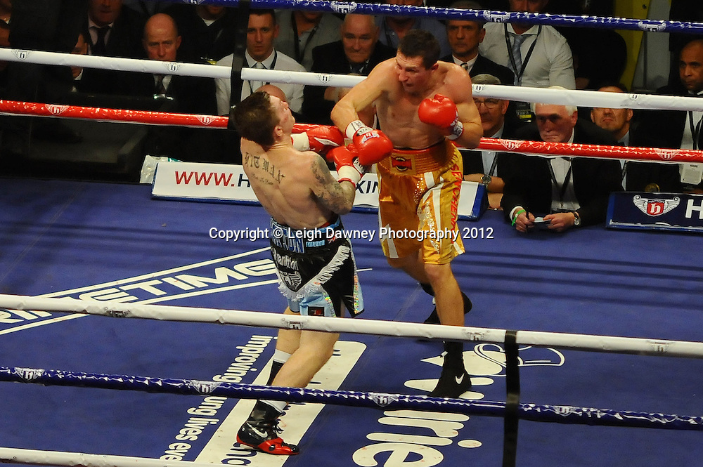 Vyacheslav Senchenko lands a right hand on Ricky Hatton in a 10x3 Welterweight fight at the Manchester Evening News Arena, Manchester on the 24th November 2012. Hatton Promotions. Pictures by Photographer Leigh Dawney of © Leigh Dawney Photography 2012.