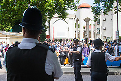London, June 23rd 2017. Police are in evidence as Muslim worshippers gather for Friday Prayers at London Central Mosque in Regents Park, following the suspected terror attack in the early Hours of Monday June 19th when Darren Osbourne, 47, from Cardiff, now charged with terrorism-related murder, is alleged to have run down a group of Muslims in Finsbury Park PICTURED: Met Police officers keep watch and control traffic as Muslims leave the mosque.